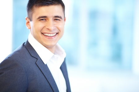 ceo: Portrait of cheerful businessman looking at camera with smile Stock Photo