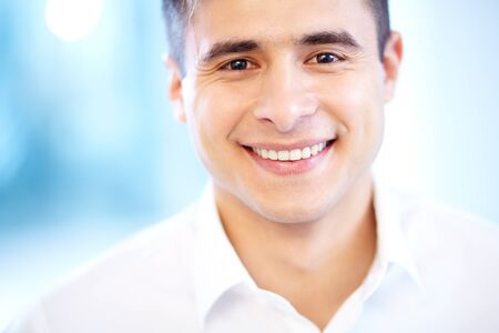 Joyful businessman looking at camera with smile photo