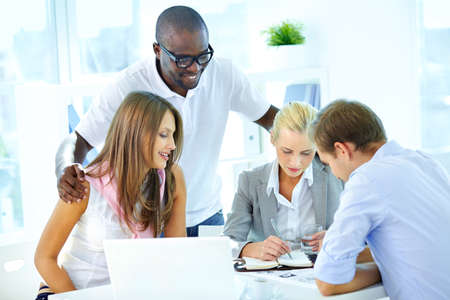 learner: Portrait of confident partners planning work in office Stock Photo