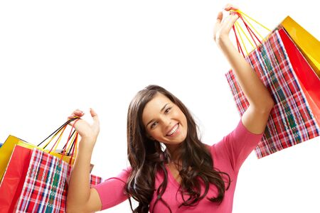 bargain: Portrait of happy girl with colorful paper bags looking at camera and smiling  Stock Photo