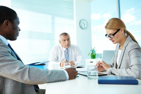 Portrait of smart employees and their boss on background at meeting Stock Photo - 17340623