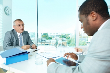 Portrait of business people interacting at meeting Stock Photo - 17340620