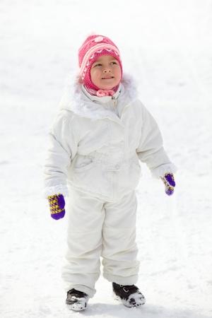 winterwear: Happy girl in winterwear standing in snow