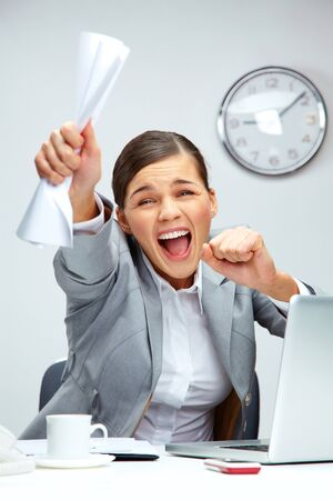 Image of young businesswoman shouting in luck photo