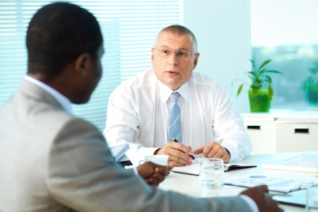Portrait of senior boss talking and his employee at meeting Stock Photo - 17331196