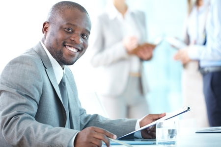 enthusiastic: Close-up shot of a smiling entrepreneur working in office