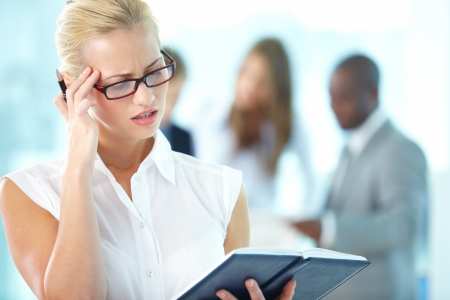 Lovely office lady trying to recall her plans for the day Stock Photo - 17359447