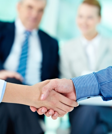 Photo of handshake of business partners after striking deal Stock Photo - 17355035