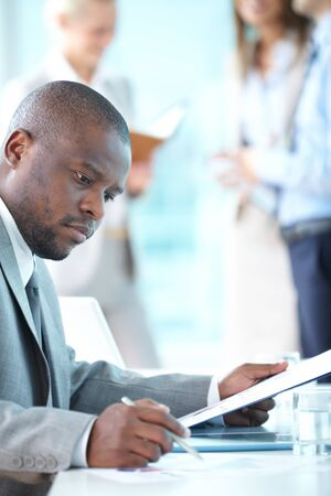 Portrait of busy leader working with papers Stock Photo - 17380774