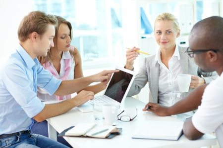 focus group: Group of friendly businesspeople having meeting