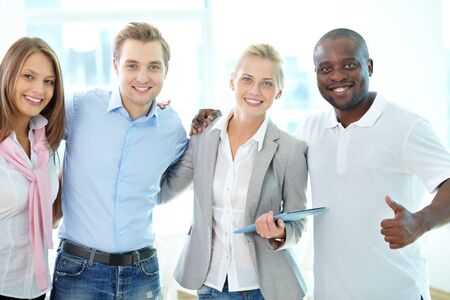 friendly people: Portrait of four business partners looking at camera with smiles Stock Photo