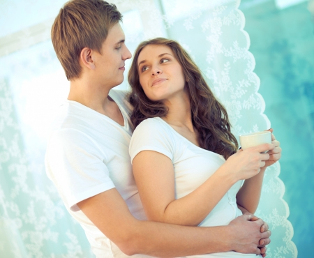 Portrait of amorous young couple looking at one another at home Stock Photo - 17422190