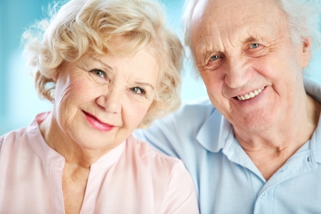 Close-up portrait of a charming elder couple looking at the viewer with a smile photo