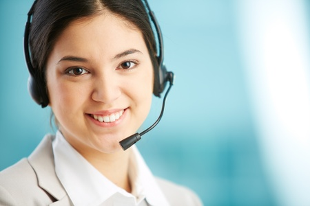 Portrait of a lovely receptionist wearing a headset Stock Photo - 17391304