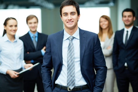 Group of friendly businesspeople with male leader in front Stock Photo - 17533787