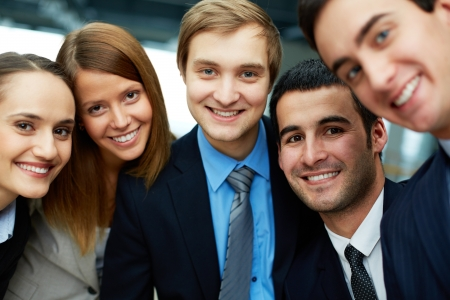 employees group: Portrait of five business partners looking at camera with smiles
