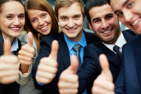company employee: Portrait of five business partners keeping thumbs up and looking at camera with smiles