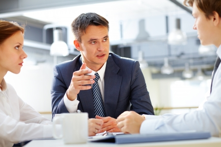 Business leader asking his employee about results Stock Photo - 17534369