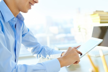 unrecognizable people: Close-up shot of a guy using a digital tablet Stock Photo
