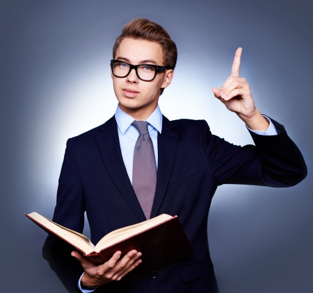 urging: Nerdy-looking businessman urging everyone to read more and be as clever as him Stock Photo