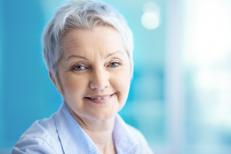 lovely businesswoman: Portrait of mature woman looking at camera Stock Photo