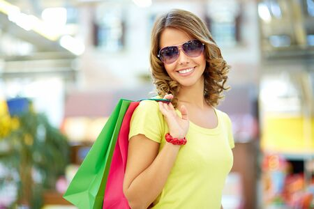 Portrait of a shopping young woman wearing cool sunglasses Stock Photo - 17622290