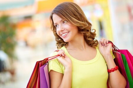 Image of a lovely shopping lady holding her purchases Stock Photo - 17622291