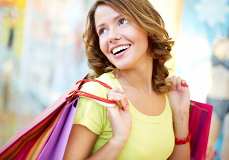 Young shopper being happy with her purchases and herself Stock Photo - 17622259