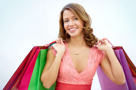 Portrait of a glamorous girl holding shopping bags Stock Photo - 17622165
