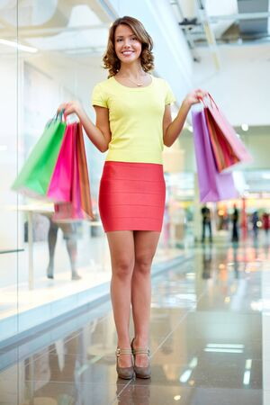 Vertical portrait of a female shopper doing her regular shopping photo