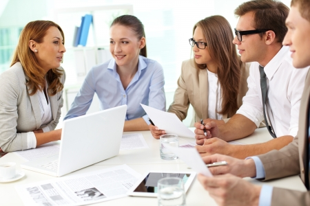 experienced: Large business group gathering to discuss business matters Stock Photo