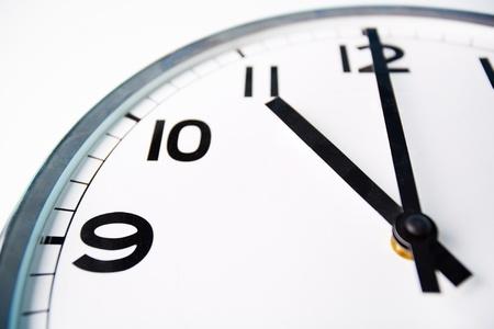 eleven: Macro shot of a clock face showing eleven o�clock
