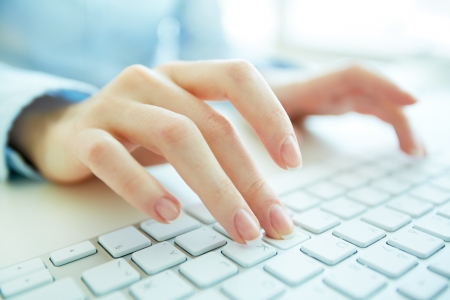 computer user: Hands of an office woman typing