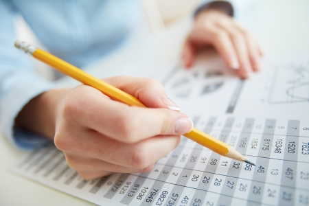 bookkeeping: Close-up image of a financial worker analyzing statistical data