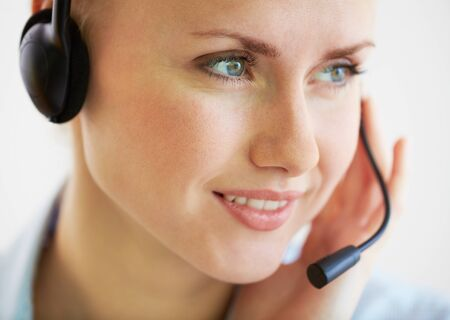 Close-up image of a smiling helpdesk operator consulting the client photo