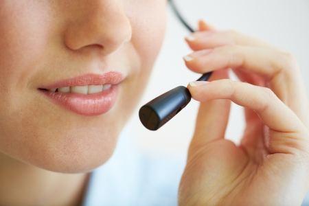 Close-up shot of a hotline worker speaking into a microphone Stock Photo - 17622219