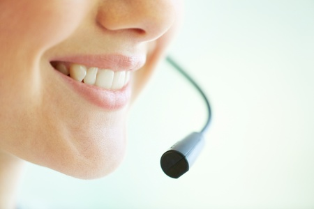 customer service representative: Smiling telemarketing operator giving a consultation concerning the product