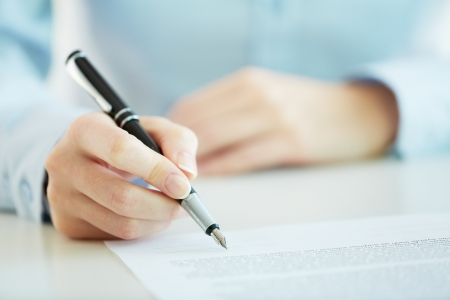 conclusion: Business worker signing the contract to conclude a deal