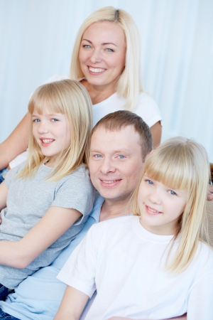 Portrait of happy couple with twin daughters smiling at camera  Stock Photo - 17622342