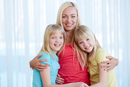 Portrait of happy woman with twin daughters looking at camera Stock Photo - 17622334