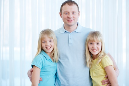 Portrait of happy man with twin daughters looking at camera Stock Photo - 17622308