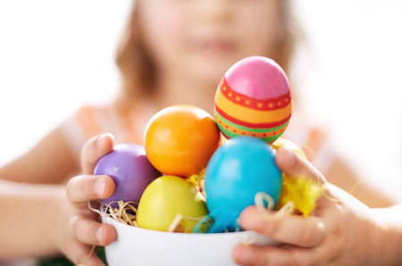 Photo of colorful Easter eggs held by little girl photo