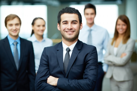 team leader: Group of friendly businesspeople with male leader in front