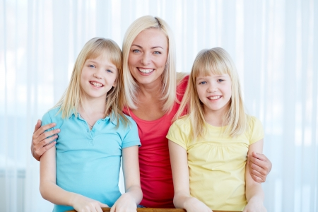 Portrait of happy woman with twin daughters looking at camera Stock Photo - 17785712