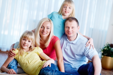 Portrait of happy family of four looking at camera at home Stock Photo - 17786074