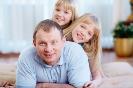 Portrait of happy man with twin daughters looking at camera Stock Photo - 17785349