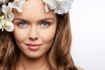 pureness: Head-shot of an adorable female model with hair decorated with flowers Stock Photo