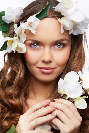 pureness: Vertical portrait of a blue-eyed girl portraying spring