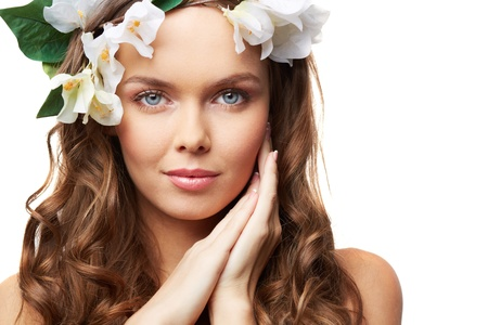 Isolated portrait of a young perfection with hair decorated with flowers photo