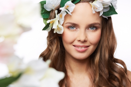 Isolated portrait of a gorgeous young woman expressing the spirit of spring photo